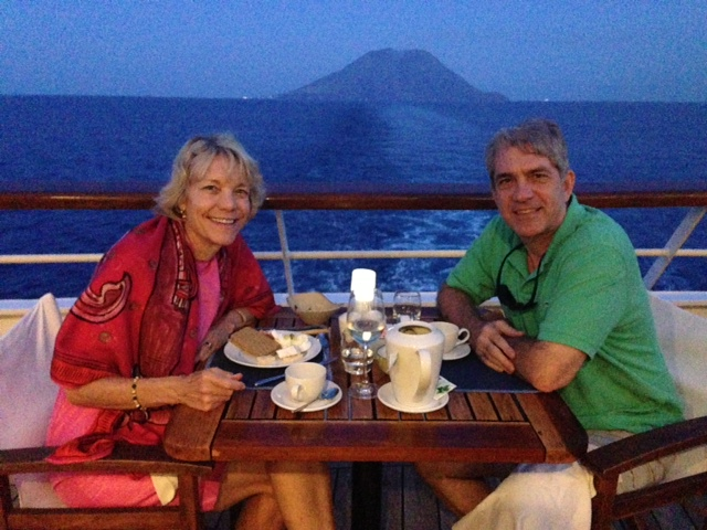 Best table on the ship, with the volcano Stromboli in the background (still smoking)